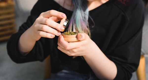 Twist and grind your weed in your grinder.